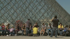 Students sat next to The Louvre, in Paris Stock Footage