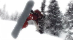 Girl on a snowboard jump on the springboard Stock Footage