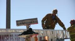 Firefighter descends a ladder Stock Footage