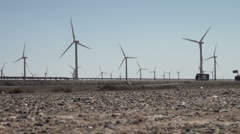 Wind turbines along Chinese express way - stock footage