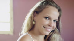 Attractive young woman in bedroom Stock Footage