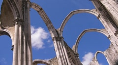 Ruins of cathedral against cloudy sky (time lapse) Stock Footage