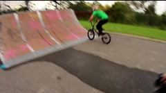 BMX bicycle back flip 180 quarter pipe Stock Footage