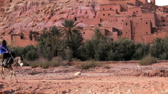 Male riding a donkey, Ait  Benhaddou, High Atlas Mountains, Morocco Stock Footage