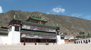 Stock Video Footage of Labrang monastery - young monks passing