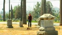 Biker Walking In Graveyard Stock Footage