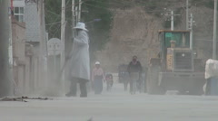 Sweeping Chinese streets, dust, poverty, woman, lady Stock Footage