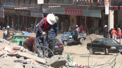 Tibetan woman drilling jackhammer industry demolition destruction China Stock Footage