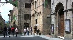 Italy San Gimignano tilts to flags 9 Stock Footage