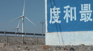 Stock Video Footage of Huge characters, wind turbines, Chinese trucks
