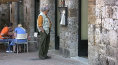 Italy San Gimignano Sid at cafe Stock Footage