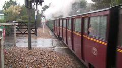 Old English steam train and carriages passing junction Stock Footage
