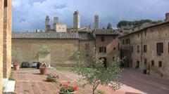 Italy San Gimignano plaza and towers Stock Footage