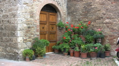 Italy San Gimignano plants by door Stock Footage