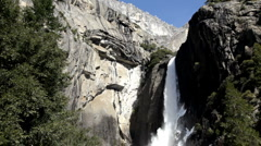 Water flowing over edge at lower Yosemite Falls Stock Footage