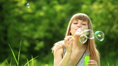 Bbeautiful girl blow bubbles-2.No wind. Tripod dinamic Stock Footage
