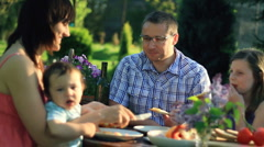 Family eating in the garden, dolly shot Stock Footage