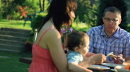Stock Video Footage of Family eating in the garden, dolly shot