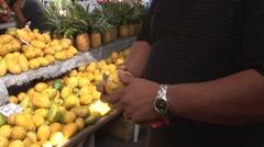 Hawaiian Man Cuts Lemon at Farmers Market Stock Footage