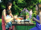 Stock Video Footage of Happy family eating in the garden