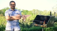 Smiling handsome man with grill, dolly shot Stock Footage