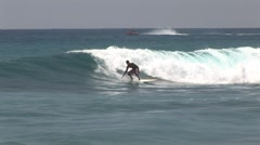 Surfer Catching Waves , Ocean Liner in Background Stock Footage