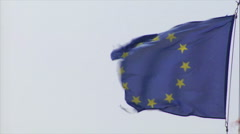 Frayed euro flag in heavy wind Stock Footage