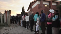 Voting Line for Elections at Sunset in South Africa GFHD Stock Footage