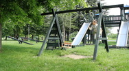 Stock Video Footage of Boy swinging on a swing