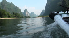 Sailing the Li river on a bamboo raft, Yangshuo, Guilin, China Stock Footage