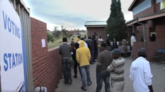 Voters in a Queue outside Voting Station, South Africa GFHD Stock Footage
