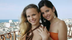 Two happy young women smiling at camera Stock Footage