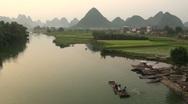 Tourist rafts amidst karst scenery near Yangshuo town, China Stock Footage