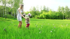Mother and child dancing in the field. Mother kisses her daughter. Dolly HD Stock Footage