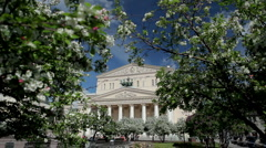 Flowering trees in front of Bolshoi Theatre in Moscow Stock Footage