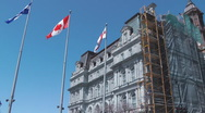Stock Video Footage of Canadian Montreal And Quebec Flags Fly Outside Montreal City Hall