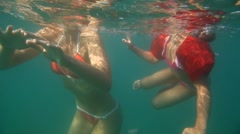 Mom and daughter swimming in the sea Stock Footage