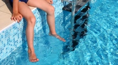 Close-up boys feet in water of pool Stock Footage