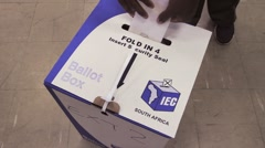 Close up Votes going into a Ballot Box, Elections in South Africa  - stock footage