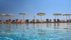 Umbrellas near pool - stock footage