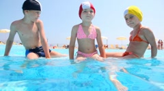 The boy and girls sitting in the pool Stock Footage