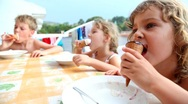 Stock Video Footage of kids are sitting at balcony and eating ice cream
