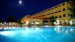 Pool in front of hotel at night Stock Footage