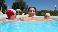 Woman and two girls are in the pool Stock Footage