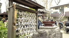 Japanese bad luck fortune papers tied to a shrine Stock Footage