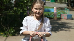 Girl on seesaw - stock footage