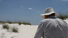 Man Walking Up Dune - stock footage
