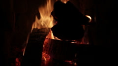 adjusting firewood in fireplace - stock footage