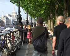 Bankside with St Pauls and People walking, London England GFSD Stock Footage