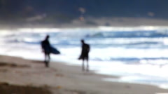 Surfers on shore 04 - out of focus Stock Footage